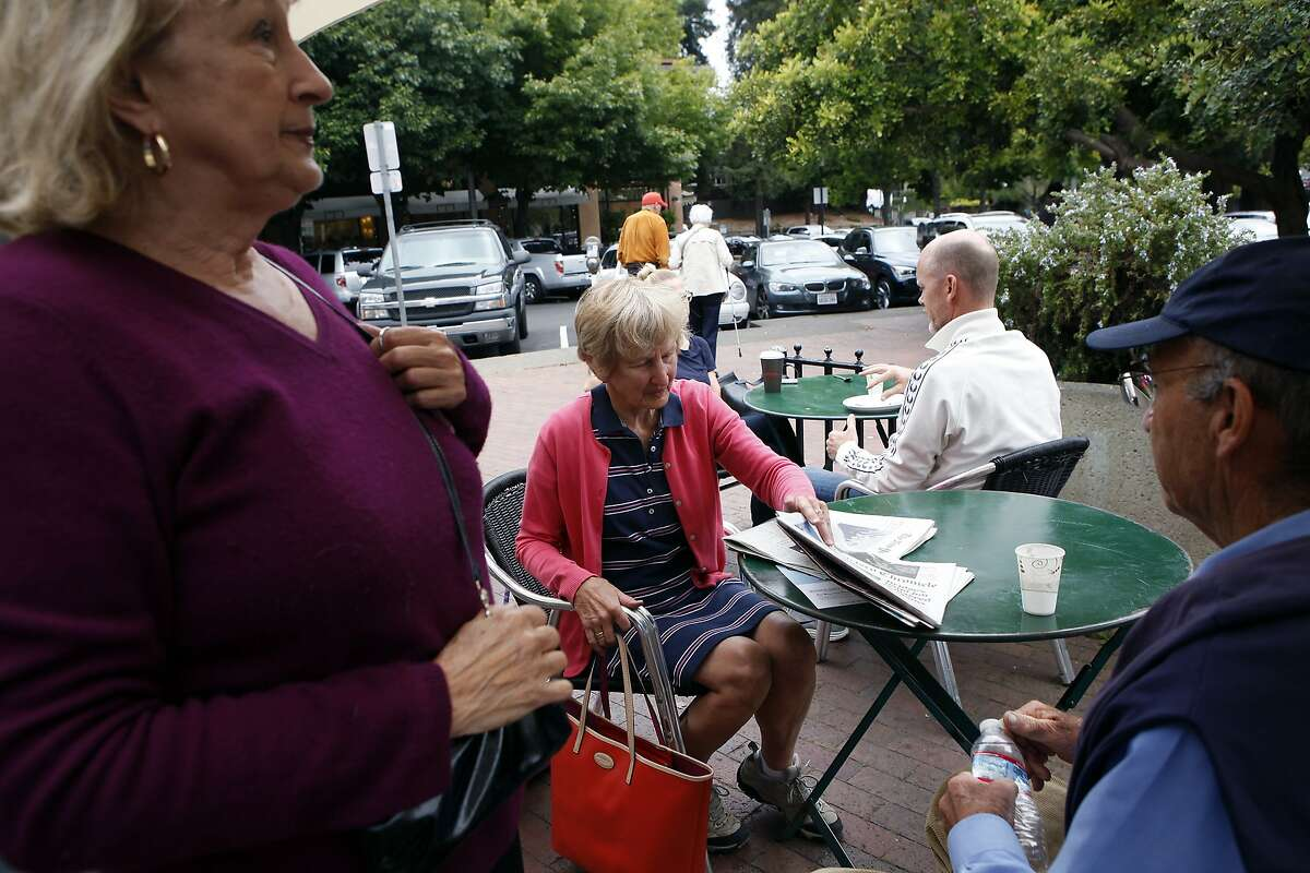 Elaine Gentile, left, talks with Susie and Britt Stitt of inverness at the Depot coffee shop and bookstore in Mill Valley, CA, Friday, July 11, 2014.