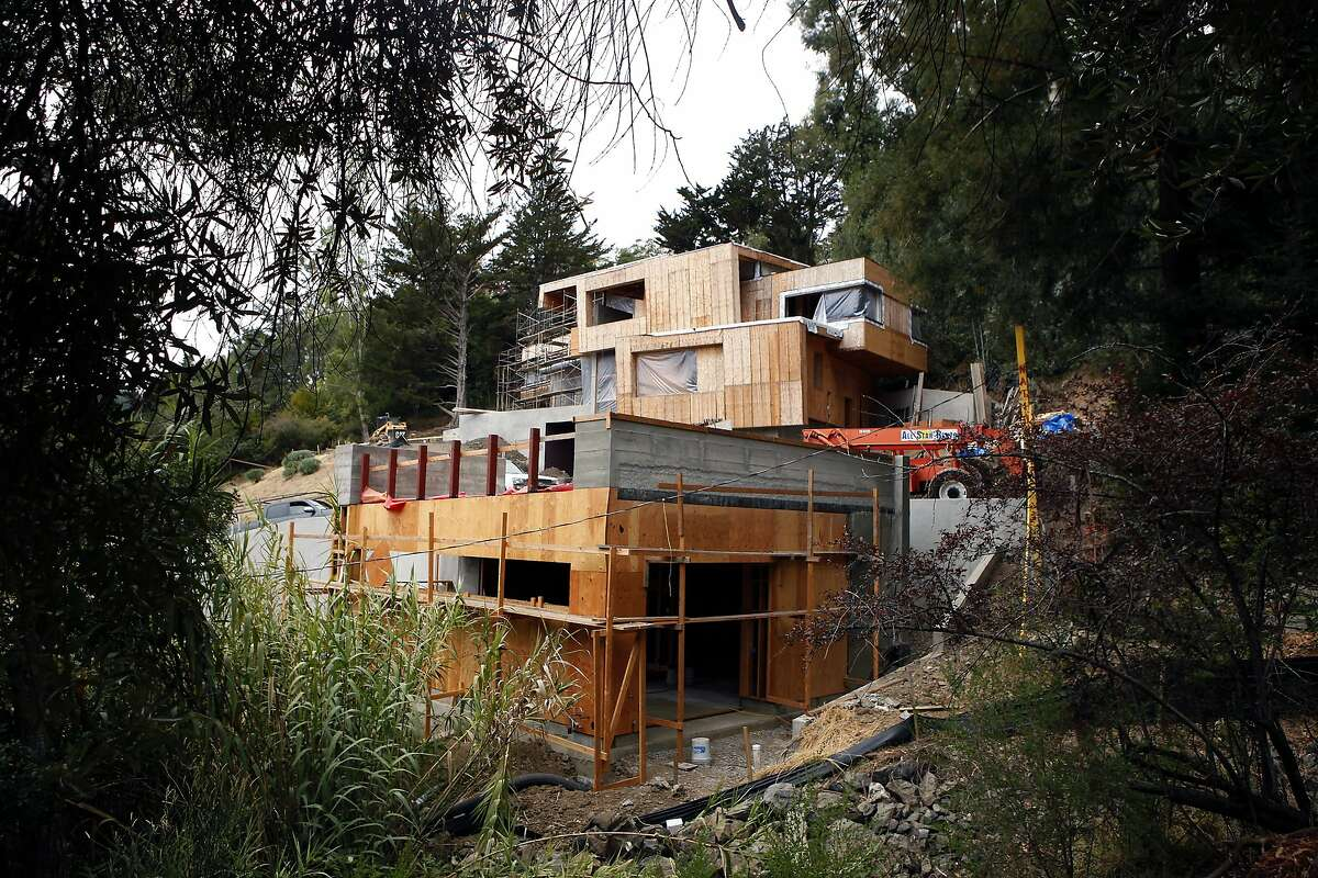 A large modern home is seen under construction on Lovell Ave. in Mill Valley, CA, Friday, July 11, 2014.