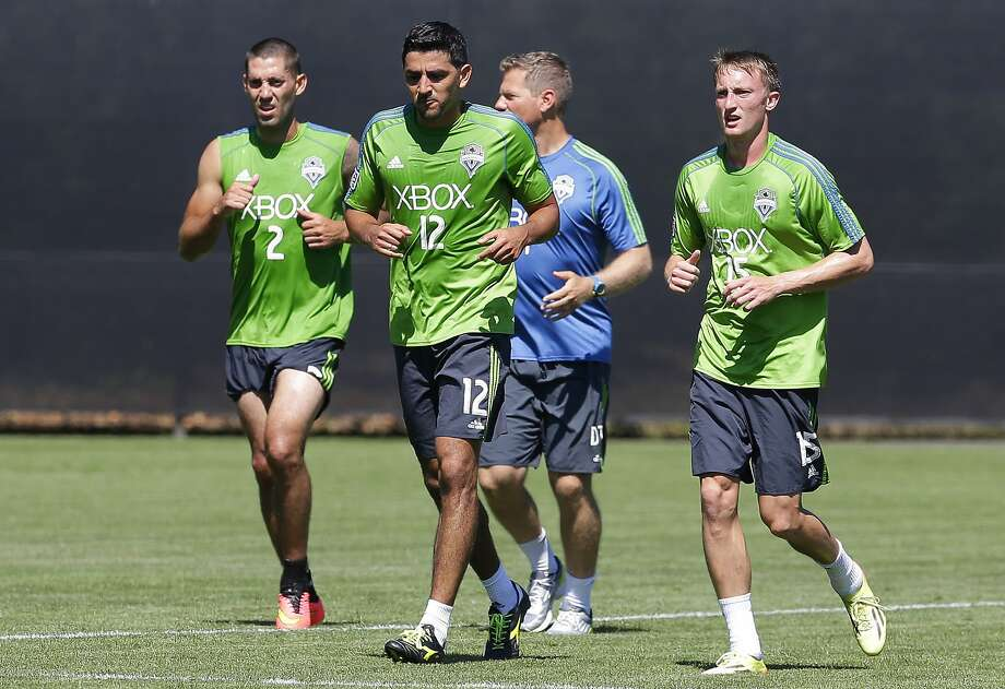 Clint Dempsey (left) trains with Seattle Sounders teammates after returning to the MLS club after a post-World Cup break. Photo: Ted S. Warren, Associated Press