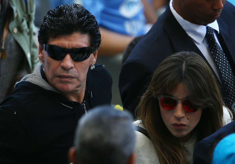 BELO HORIZONTE, BRAZIL - JUNE 21:  Diego Maradona (L) and his daughter Giannina Maradona look on during the 2014 FIFA World Cup Brazil Group F match between Argentina and Iran at Estadio Mineirao on June 21, 2014 in Belo Horizonte, Brazil.  (Photo by Ian Walton/Getty Images) Photo: Ian Walton, Getty Images