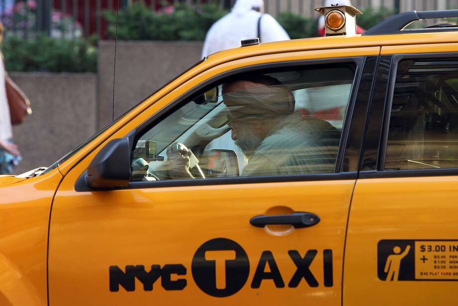 New York taxi drivers are fighting ride-service apps. They got a boost from state officials, who sued to block Lyft operations. Photo: Mehdi Taamallah, AFP/Getty Images