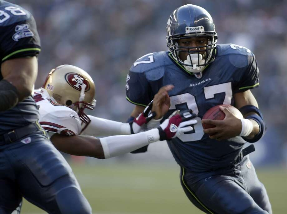 Shaun Alexander — Seahawks  Seahawks stats (2000-07): 119 games, 112 TD, 2,176 carries for 9,429 yards, 214 receptions for 1,511 yards Career stats (2000-08): 123 games, 112 TD, 2,187 carries for 9,453 yards, 215 receptions for 1,520 yards  Alexander was named NFL MVP for the 2005 season, when he set a single-season touchdown record (since broken) and led the Seahawks to their first-ever Super Bowl appearance. Though Seattle lost and the running back quickly lost his dominance, he certainly belongs among the Emerald City's best-ever football players. He holds the Hawks' franchise record with 9,429 rushing yards and is second all-time in scoring with 672 total points. Photo: Mike Urban, Seattle P-I Archives