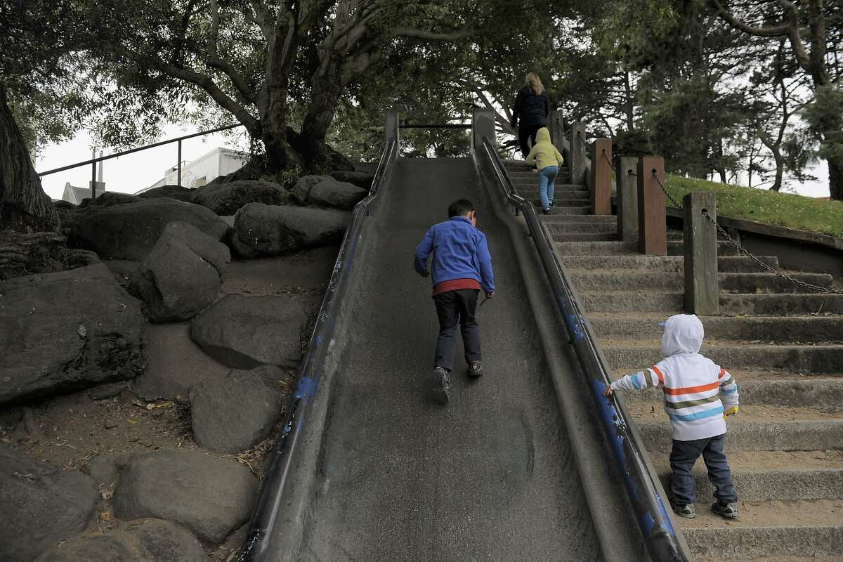 Jackson Dorazo, left, and Gavin Byrne run up a slide at Mountain Lake Park on July 02, 2014 in San Francisco, CA. A group of parents, with the blessing of a complex system of bureaucracy, advocacy and philanthropy, are working to create a new playground at Mountain Lake Park.