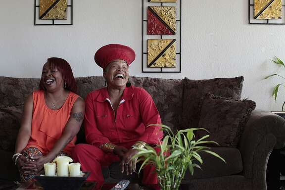 Cassandra Steptoe, left, and Rhonda Jones share a laugh at Cassandra's apartment in San Francisco, Calif. on Friday, July 11, 2014. UCSF has teamed up with the Medea Project to create a new program for women with HIV.