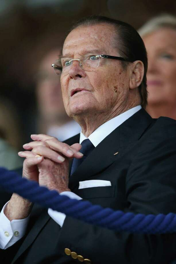 "Roger Moore, 2014Moore's last role was in a TV movie reboot of his series ""The Saint"" in 2013, in which he played Jasper. Photo: Christof Koepsel, Getty Images / 2013 Getty Images"