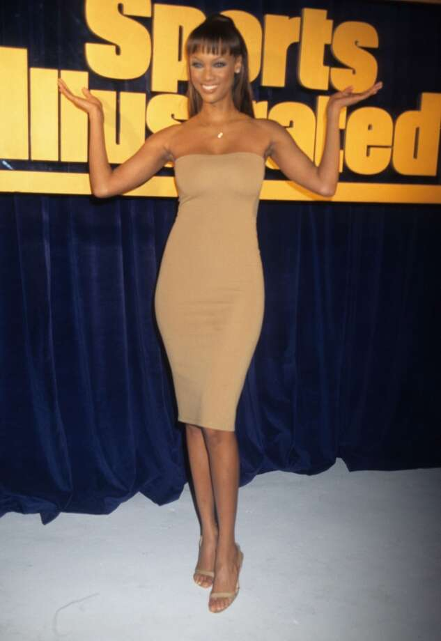 Supermodel Tyra Banks poses for Sports Illustrated in 1997, age 23. She was the first African American model to appear on the swimsuit issue cover. Photo: Rose Hartman, WireImage