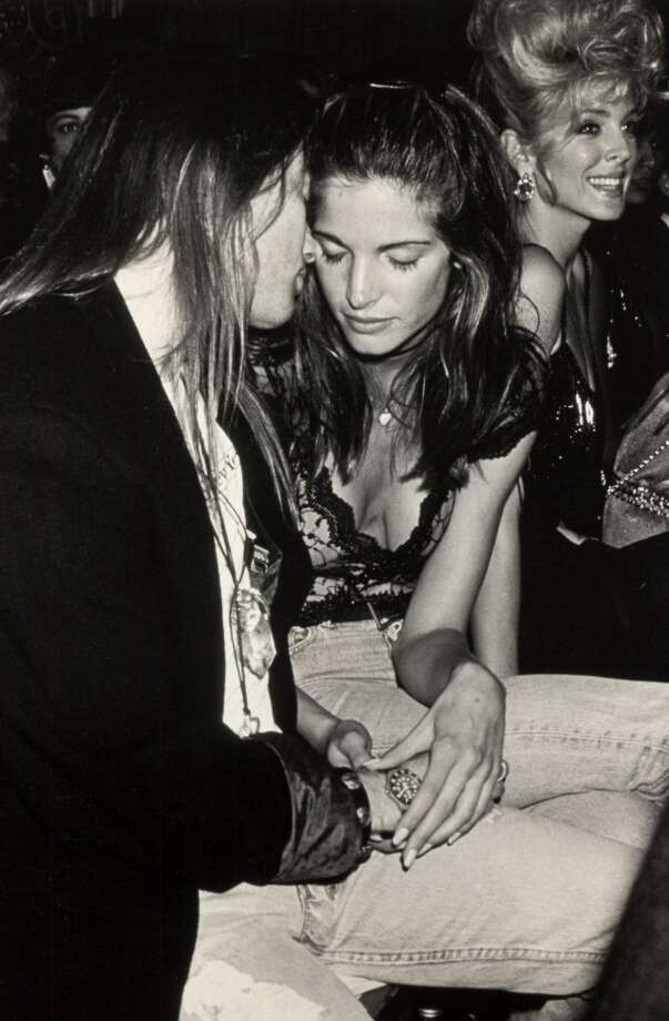 Stephanie Seymour, seen here in 1991 at age 23 with then-boyfriend Axl Rose, appeared in many Sports Illustrated Swimsuit issues, Victoria's Secret catalogues and posed for Playboy. Photo: Ron Galella, WireImage