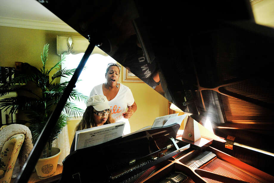 "Michele Hilton plays the piano as her friend, Rosa Davis, sings to the hymn ""In the Garden"" at Hilton's home in Stamford, Conn., on Monday, June 30, 2014. Photo: Jason Rearick / Stamford Advocate"