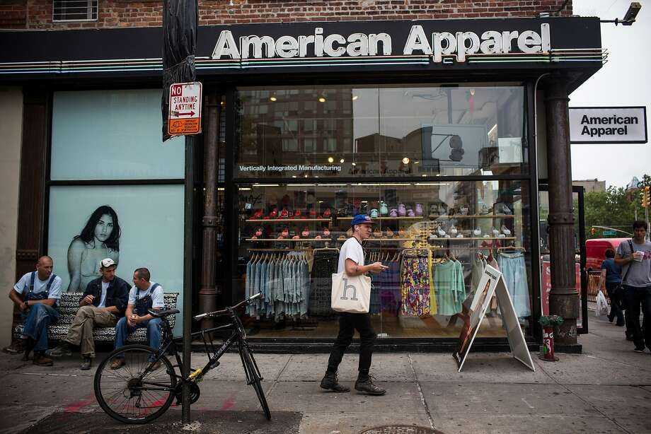 FILE - JULY 9:  According to reports July 9. 2014, American Apparel has reached a deal in principle with the shareholders,  the Standard General hedge fund and suspended CEO Dov Charney in which Standard General would fund the retailer with $25 million as part of the deal. The role of Dov Charney will play in the company remains unclear. NEW YORK, NY - JUNE 19:  People walk past an American Apparel store on June 19, 2014 in New York City. American Apparel's board has voted to remove the company's controversial CEO, Dov Charney.  (Photo by Andrew Burton/Getty Images) Photo: Andrew Burton, Getty Images