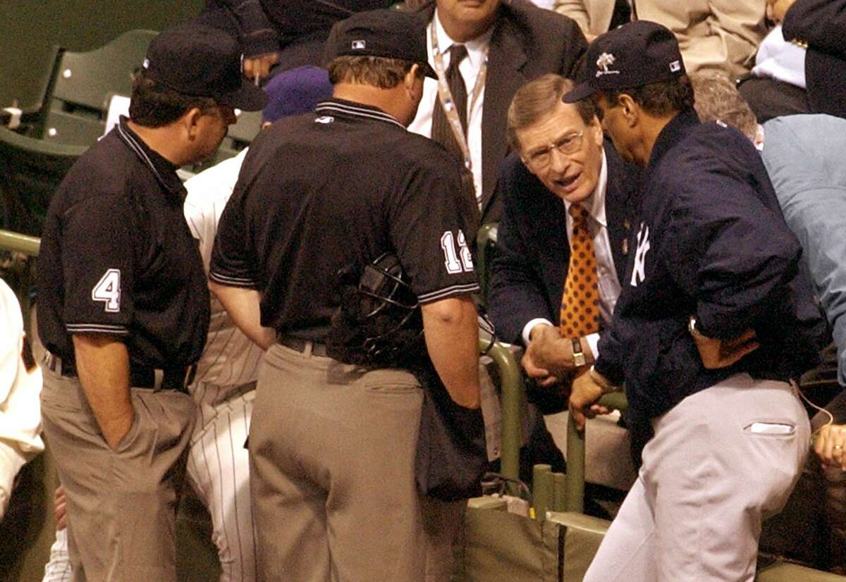 Baseball Commisioner Bud Selig, second from right, talks with American League manager Joe Torre, right, and National League manager Bob Brenly, hidden, as umpires listen during the 11th inning of the All-Star Game in Milwaukee, Tuesday, July 9, 2002. The game was called at the end of the inning with the score tied at 7-7. (AP Photo/Darren Hauck) Ran on: 07-04-2007 Bud Selig conferred with managers and umpires before calling the 2002 All-Star Game a 7-7 tie.