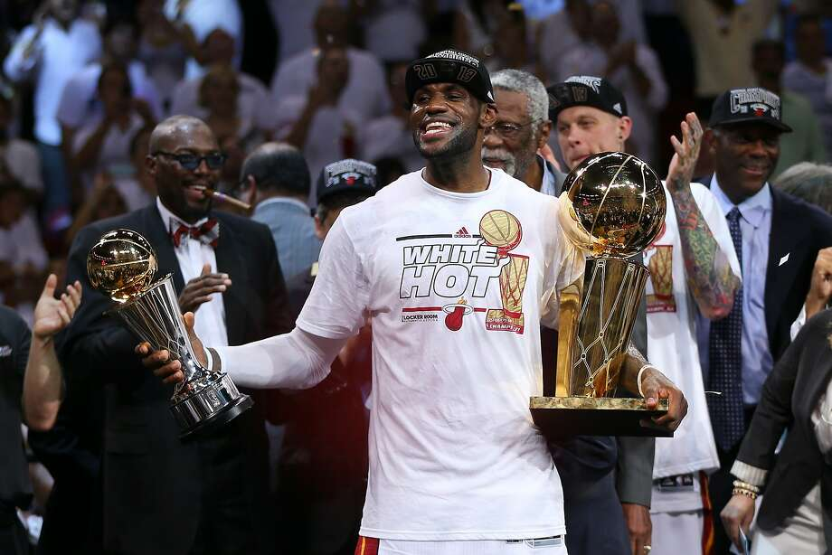 LeBron James went to the NBA Finals for four straight years and won two titles while with the Miami Heat. His mission now is to win one for Cleveland, near where he was raised. Photo: Mike Ehrmann, Getty Images