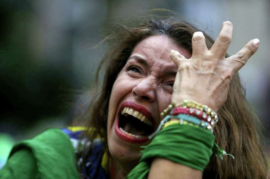 A Brazil soccer fan cries as Germany scores against her team during the semifinal World Cup match, won by Germany 7-1 last week. A reader wonders why fans think these low-scoring affairs are so exciting. Photo: Bruno Magalhaes / Associated Press / AP