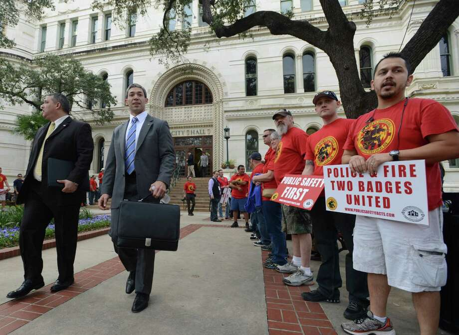 Police and firefighter union members gathered in force earlier this year as City Council prepared to hear the recommendations of a task force considering their retirement and health benefits. Nonprofit organizations should be funded fairly for their role in the community, too. Photo: Billy Calzada / San Antonio Express-News / San Antonio Express-News