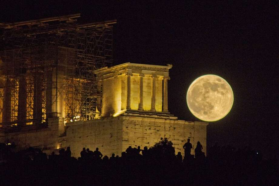 A supermoon rises over the Acropolis of Athens, Greece. Photo: Nikolaos Pantazis, Flickr Vision