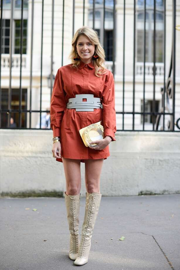 Fashion blogger Helena Bordon poses wearing a Tod's outfit, Charlotte Olympia clutch and Miu Miu shoes before the Atelier Versace show on July 6, 2014 in Paris, France. Photo: Vanni Bassetti, Getty Images