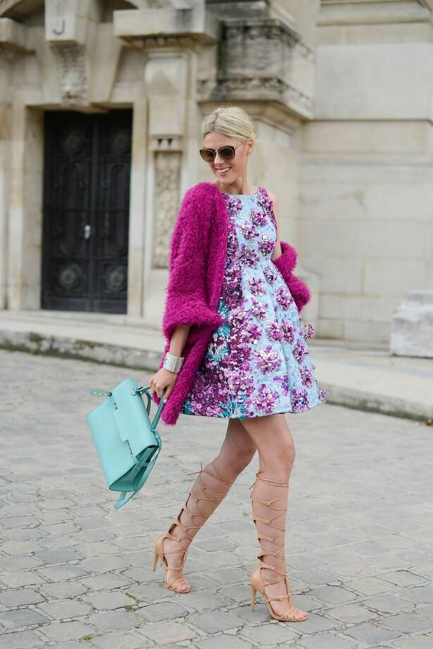 Fashion blogger Sofie Valkiers wears a Mary Katranzou dress, a Delvaux bag and Schutz shoes before the Chanel show on July 8, 2014 in Paris, France. Photo: Vanni Bassetti, Getty Images