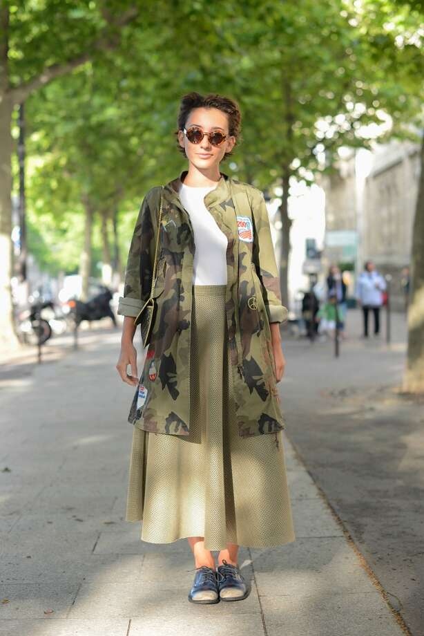 Elisa Carassai poses wearing a vintage jacket, Gap shirt, Samuji skirt, Officine Creative shoes and Emporio Armani sunglasses before Atelier Versace show on July 6, 2014 in Paris, France. Photo: Vanni Bassetti, Getty Images