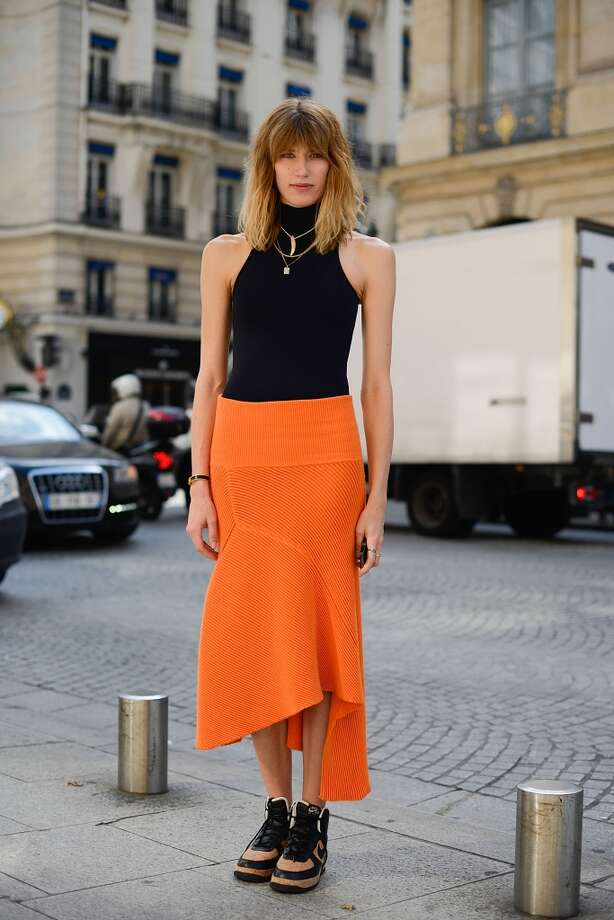 Veronika Heilbrunner poses wearing an Acne dress and Nike sneakers after Schiapparelli show on July 7, 2014 in Paris, France. Photo: Vanni Bassetti, Getty Images