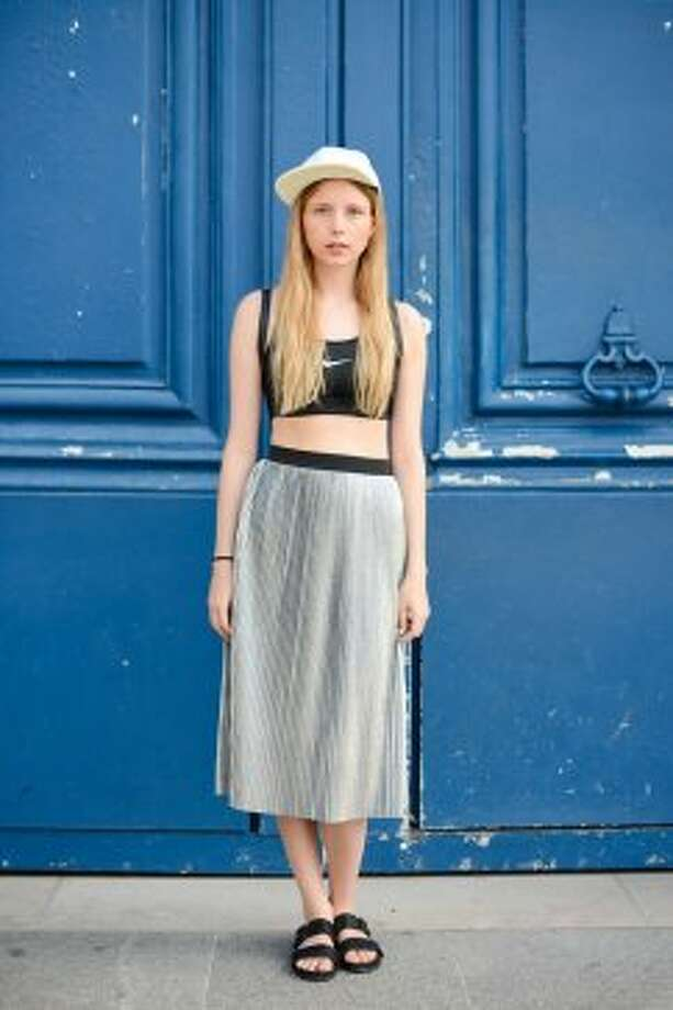 Fashion Blogger Marie Jensen poses wearing a Nike top, a Monki skirt and Vagabond sandals after Schiapparelli show on July 7, 2014 in Paris, France. Photo: Vanni Bassetti, Getty Images
