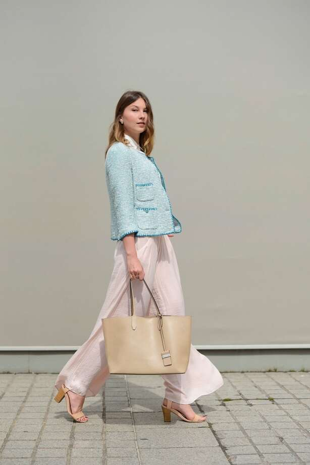 Fashion Blogger Angelica Ardasheva poses wearing Zara jacket, shirt and pants, Mango shoes and Gianni Chiarini bag after the Schiapparelli show on July 7, 2014 in Paris, France. Photo: Vanni Bassetti, Getty Images