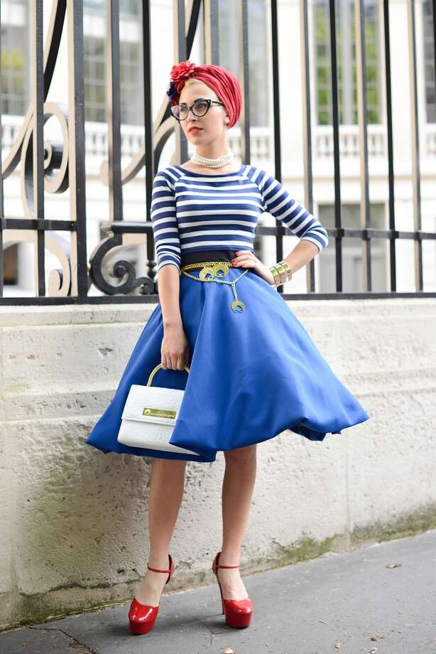 Fashion blogger Eva Ana Kazic poses wearing a B. Polanec skirt, All around Eve bag and jewelry and Different Eyewear x All around Eve glasses before the Atelier Versace show on July 6, 2014 in Paris, France. Photo: Vanni Bassetti, Getty Images