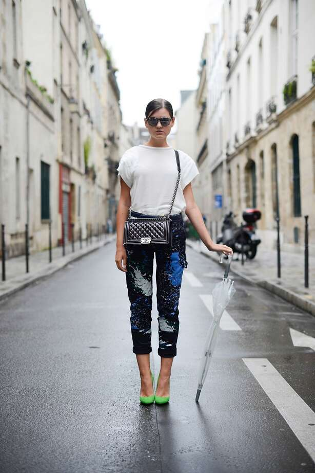 Fashion blogger Elvira Abasova poses wearing an Iro top, Tibi pants, Violavinca shoes, Chanel clutch and Armani sunglasses before the Fred Sathal show on July 6, 2014 in Paris, France. Photo: Vanni Bassetti, Getty Images
