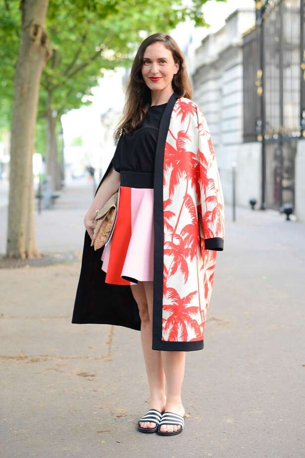 Grazia Germany fashion editor Stephanie Morcinek poses wearing a Fausto Puglisi coat and skirt and Adidas sliders before  Atelier Versace show on July 6, 2014 in Paris, France. Photo: Vanni Bassetti, Getty Images