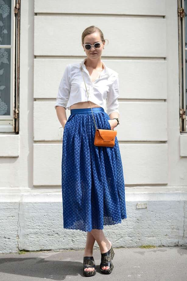 Fashion Blogger Mia Stoelen poses wearing a Filippa K shirt and bag, H&M skirt, Fendi shoes, Hermes bracelet and Kaibosh sunglasses before the Dior show on July 7, 2014 in Paris, France. Photo: Vanni Bassetti, Getty Images