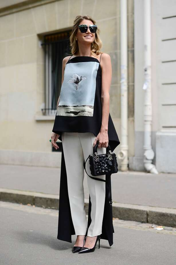 Fashion Blogger Helena Bordon poses wearing a Dior total look before the Dior show on July 7, 2014 in Paris, France. Photo: Vanni Bassetti, Getty Images