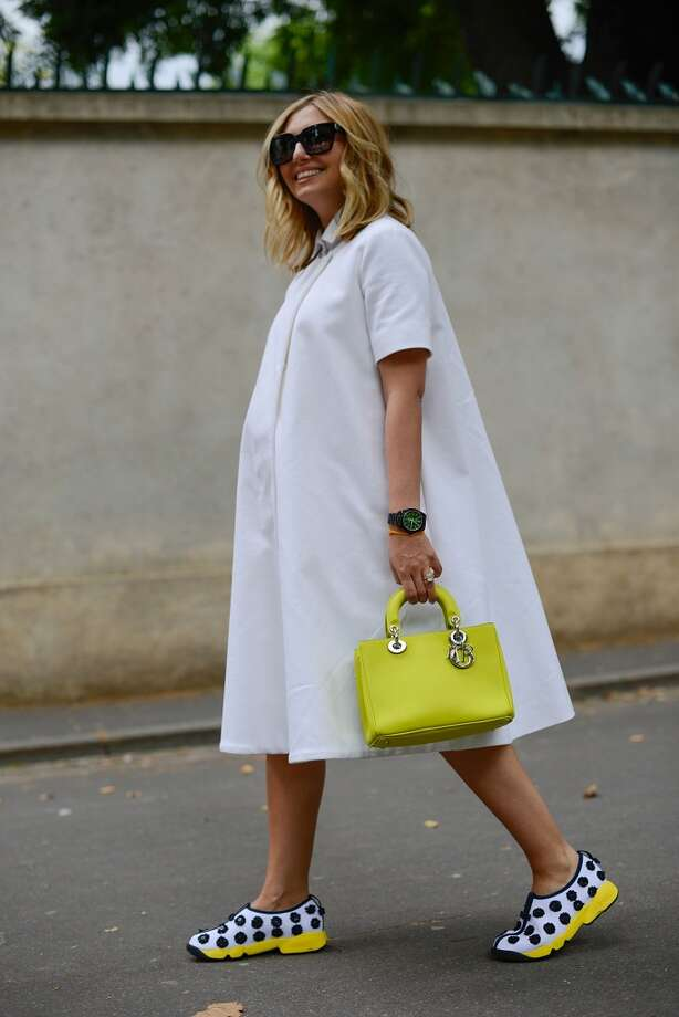 Journalist Nasiba Adilova poses wearing an Emilia Wickstead dress and Dior shoes and bag after the Dior show on July 7, 2014 in Paris, France. Photo: Vanni Bassetti, Getty Images