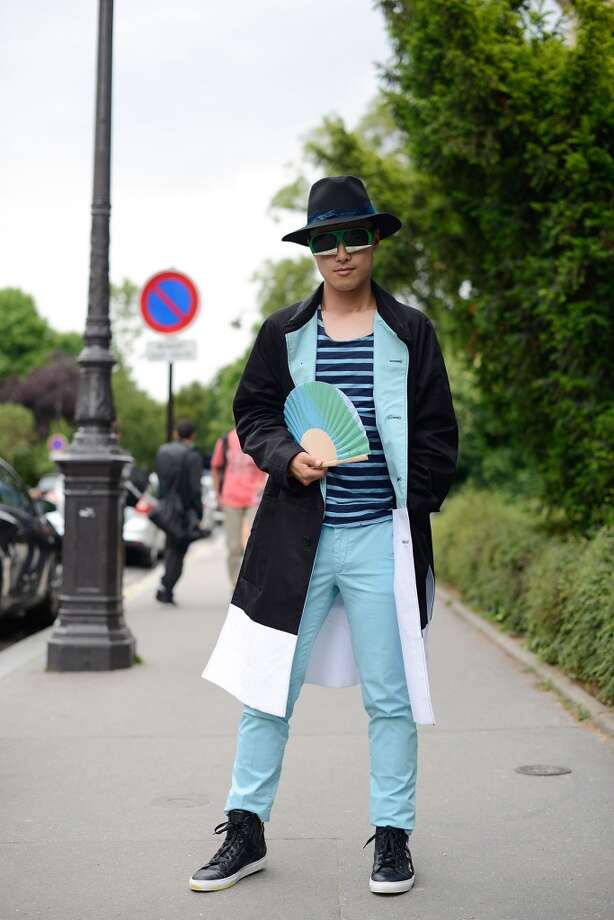 Fashion Blogger Peter Xu poses wearing a Kenzo coat, Zadig & Voltaire shirt and pants, Cesare Casadei shoes and Walter Van Beirendonk sunglasses on July 7, 2014 in Paris, France. Photo: Vanni Bassetti, Getty Images