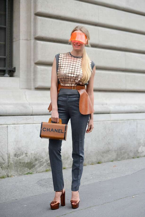 Tetya Motya poses wearing a Marco de Vincenzo top, Gucci pants and shoes, vintage Chanel bag and Courreges visor before the Giambattista Valli show on July 7, 2014 in Paris, France. Photo: Vanni Bassetti, Getty Images
