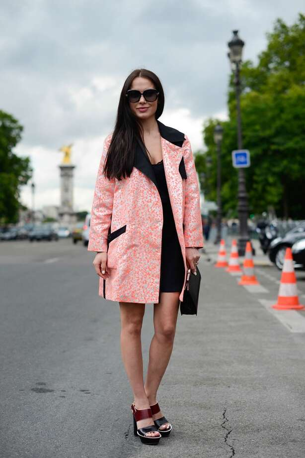 Fashion designer Yasya Minochkina poses wearing Yasya Minochkina dress and coat, Marni shoes and Dior bag after the Chanel show on July 8, 2014 in Paris, France. Photo: Vanni Bassetti, Getty Images