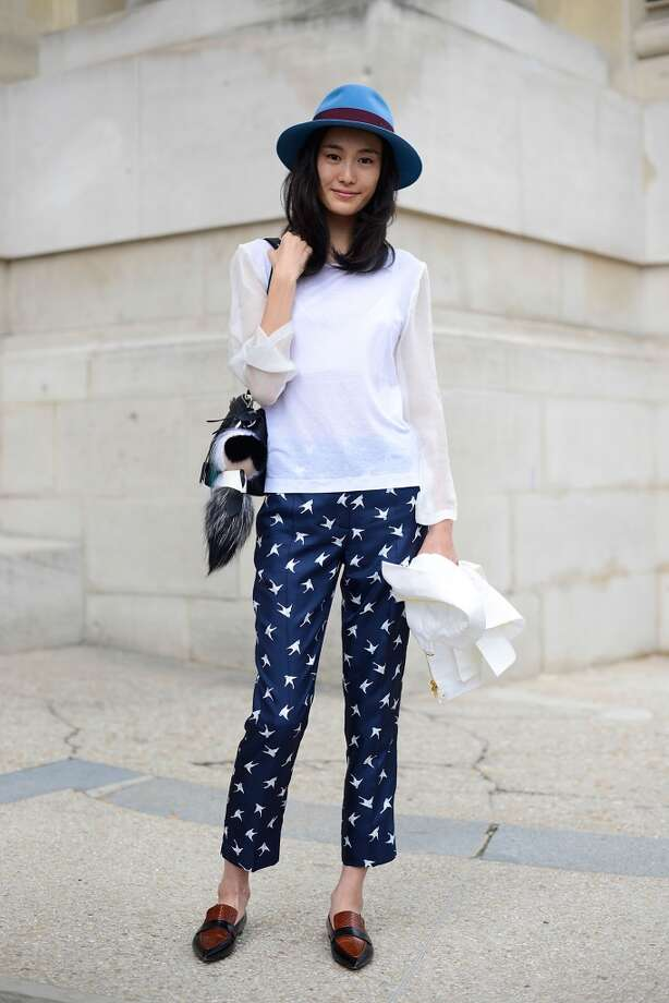 Model Shu Pei poses wearing Dries Van Noten shirt, Nina Ricci pants, Fendi bag and Celine shoes after the Chanel show on July 8, 2014 in Paris, France. Photo: Vanni Bassetti, Getty Images