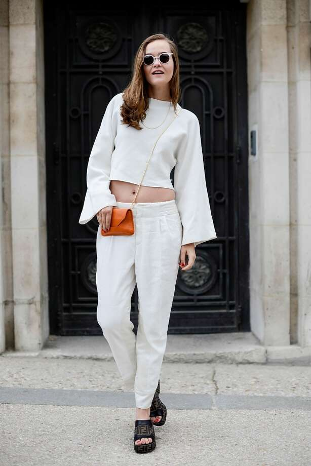 Fashion blogger Mia Stoelen poses wearing a Zara top, Filippa K pants and bag, Fendi shoes and Kaibosh sunglasses after the Chanel show on July 8, 2014 in Paris, France. Photo: Vanni Bassetti, Getty Images