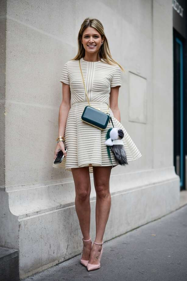Fashion blogger Helena Bordon poses wearing Elie Saab dress and bag after the Elie Saab show on July 9, 2014 in Paris, France. Photo: Vanni Bassetti, Getty Images
