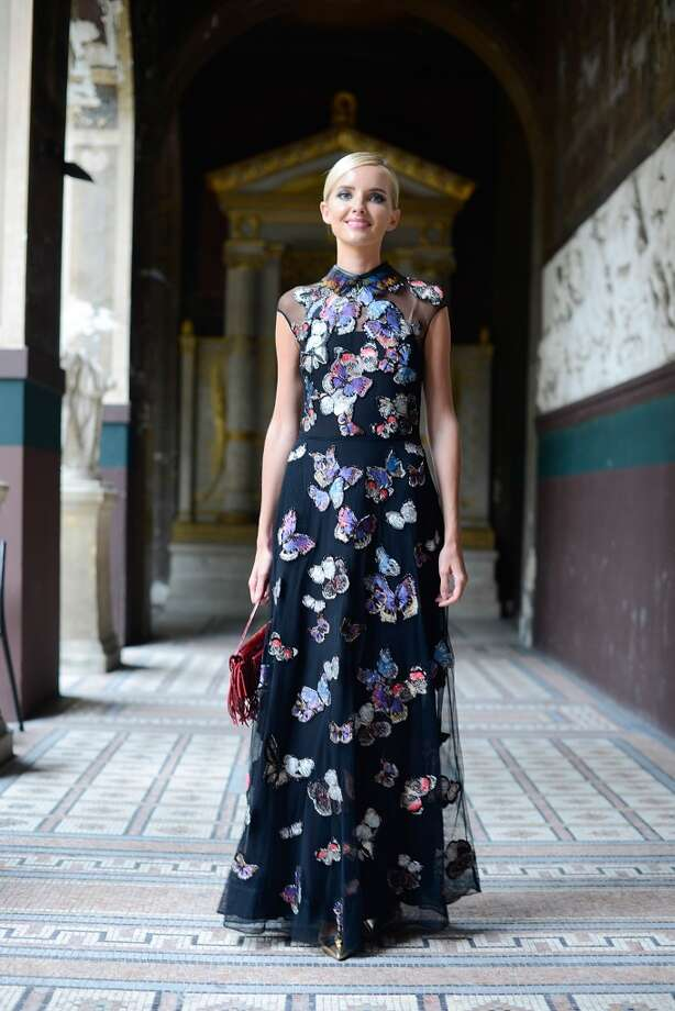 Natalia Kim poses wearing a Valentino dress after the Vionnet show on July 9, 2014 in Paris, France. Photo: Vanni Bassetti, Getty Images