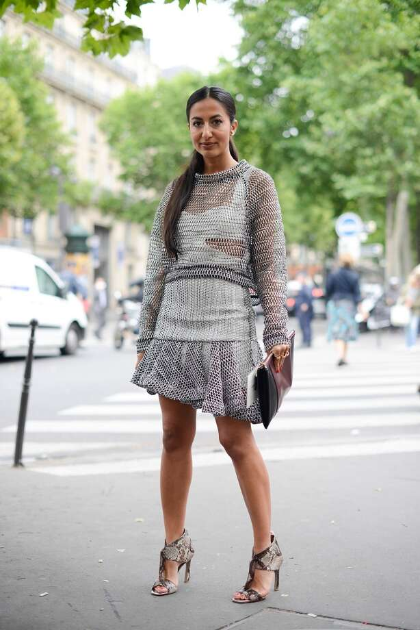 Marieclaire.com fashion contributor Nausheen Shah poses wearing a Jay Ahr dress, Ferragamo shoes and Jil Sander bag after the Elie Saab show on July 9, 2014 in Paris, France. Photo: Vanni Bassetti, Getty Images