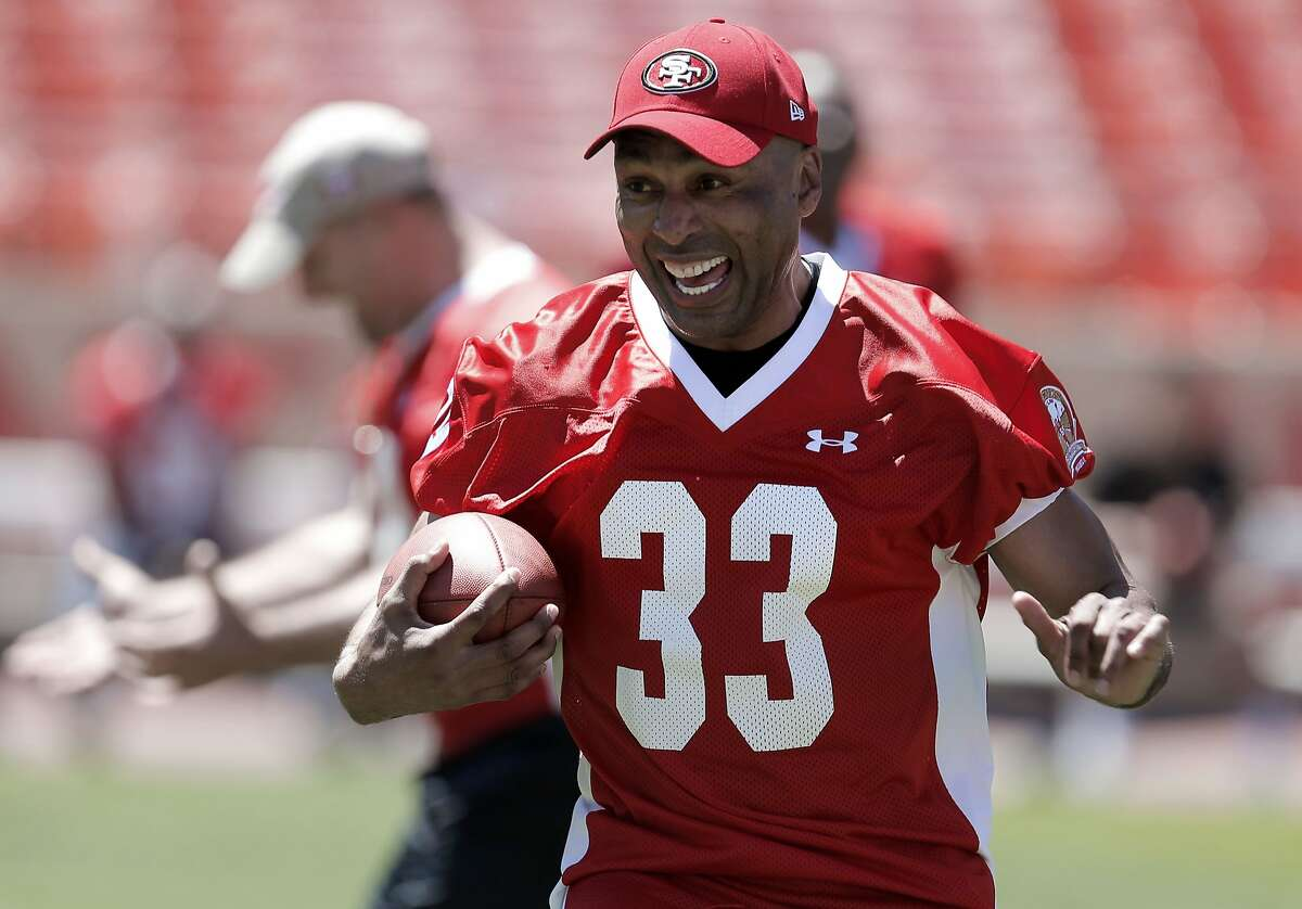 Roger Craig shows a little excitement running a few plays on Friday July 11, 2014, in San Francisco, Calif. Former football greats gather to practice a day before the Legends of Candlestick game, the final football game to be held at Candlestick Park.