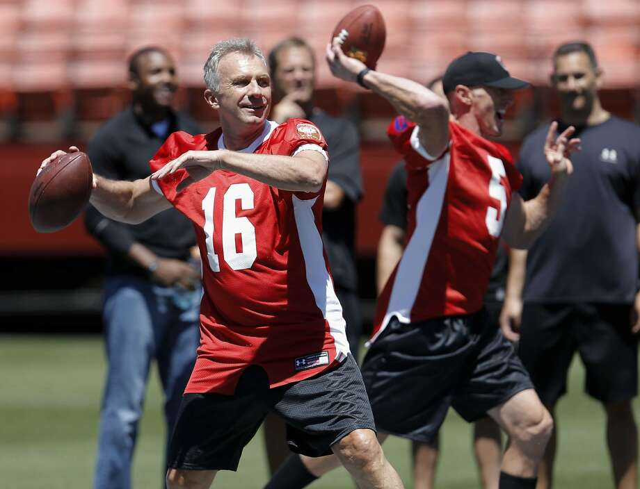 Jeff Garcia (right) throws with Joe Montana, his boyhood idol, during practice for the final game at Candlestick Park. Photo: Michael Macor, The Chronicle
