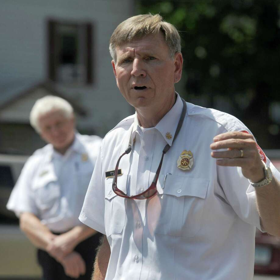 Assistant Fire Chief T.J.Wiedl, speaks at a flag retirement ceremony marking the retirement of Danbury Fire Chief Geoff Herald Friday, July 11, 2014. Mayor Boughton has named Wiedl  Interim Fire Chief. Photo: Carol Kaliff / The News-Times