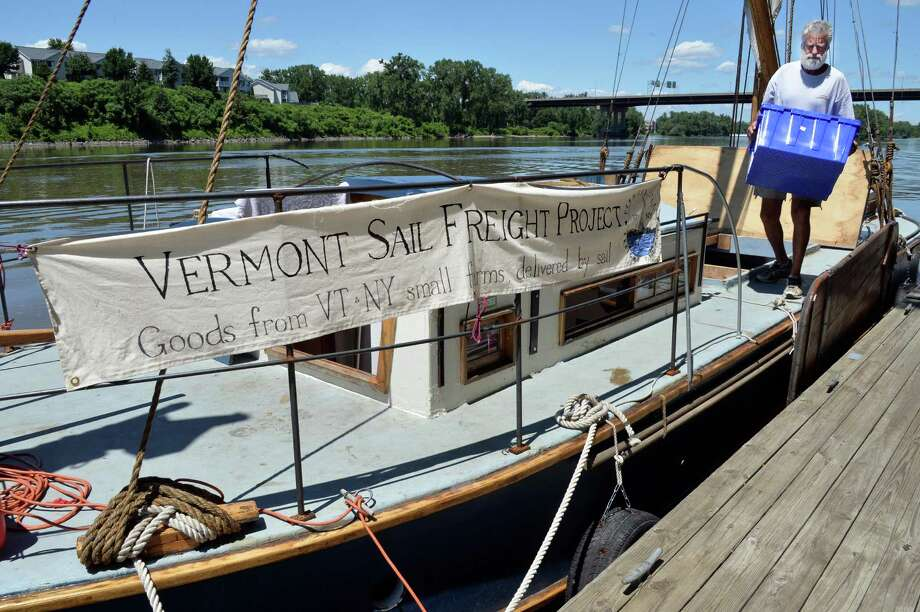 Captain Steve Schwartz unloads the Vermont Sail Freight's sailing barge, Ceres, docked at the Troy Marina Friday, July 11, 2014, in Troy, N.Y. The vessel was on her way back to northern Vermont after stops along the Hudson River. (John Carl D'Annibale / Times Union) Photo: John Carl D'Annibale / 00027758A