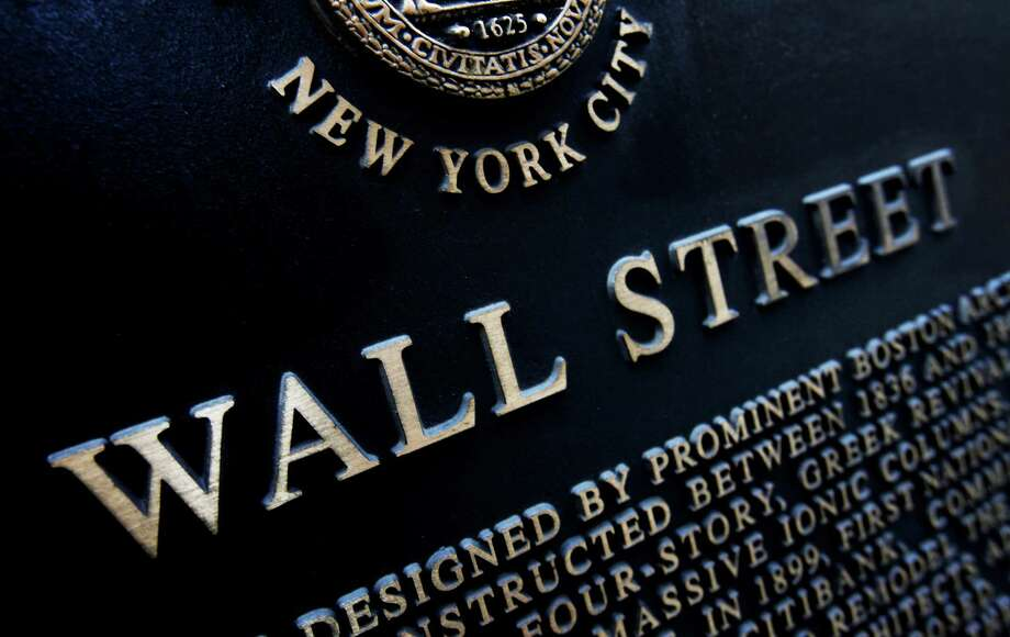 FILE - This Jan. 4, 2010 file photo shows an historic marker on Wall Street in New York.  U.S. stocks are opening lower Friday, July 11, 2014, and are headed for their biggest weekly loss since April. (AP Photo/Mark Lennihan, File) ORG XMIT: NYBZ171 Photo: Mark Lennihan / AP