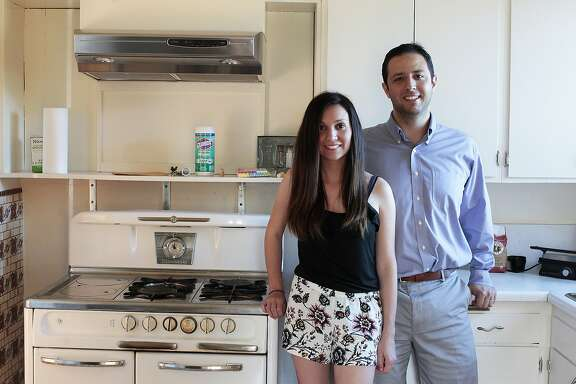 Arin, left, and Merve Keskin pose in their new home that they've lived in for a little over a month South San Francisco, Calif. on Thursday, July 10, 2014. The Keskins had help from Arin's mother who put a 36% downpayment on the home.