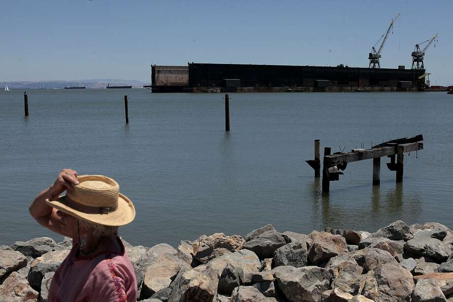 A woman visits Terry Francois Boulevard at Agua Vista Park between McCovey Cove and Mission Rock. Photo: James Tensuan, The Chronicle