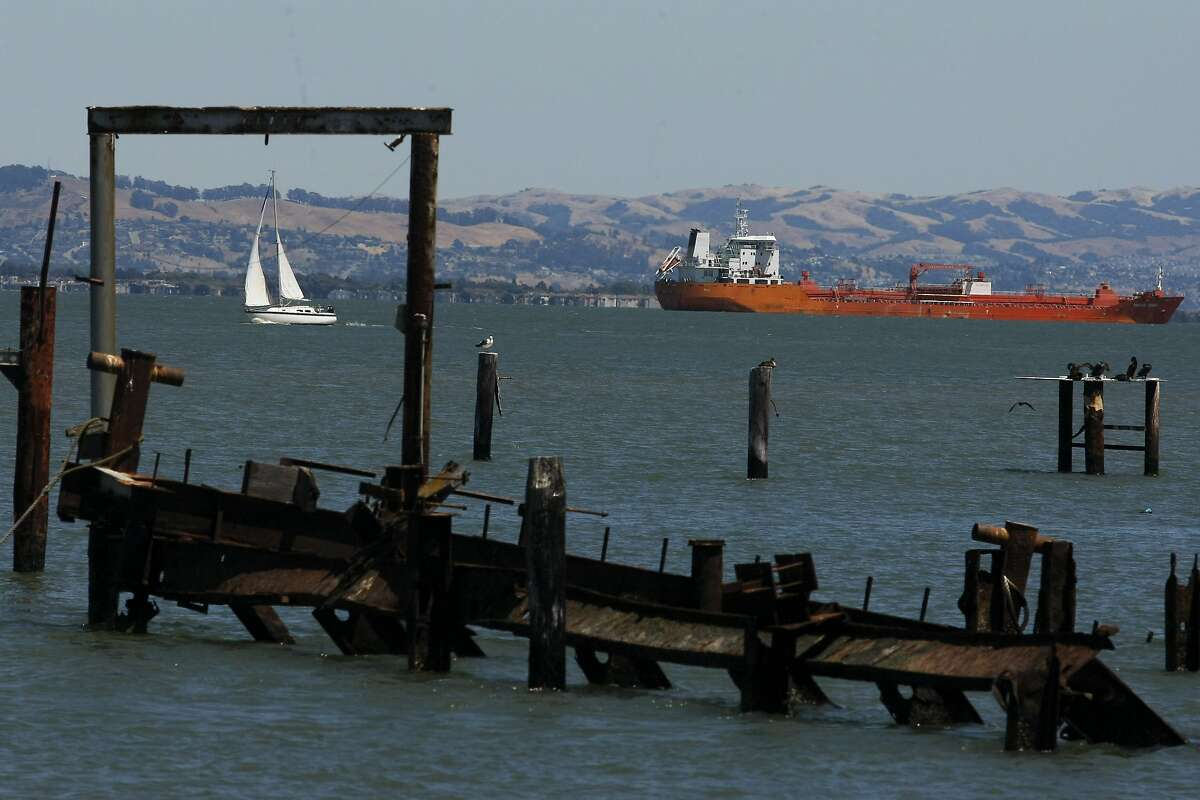 Boats are framed by old docks at Agua Vista Park as they pass through the bay in San Francisco, Calif. on Friday, July 11, 2014. Between McCovey Cove and and Mission Rock is a part of the Waterfront Park that many people do not visit.