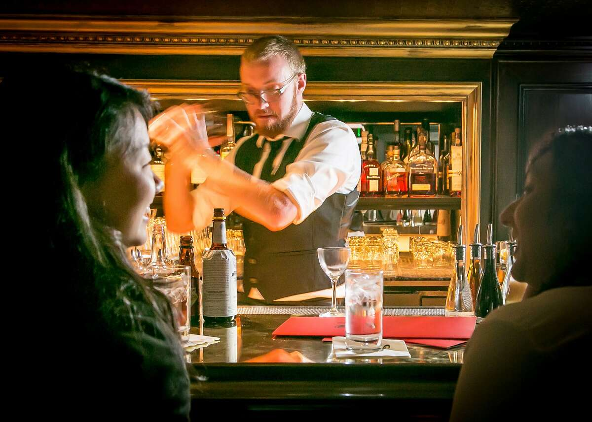 Bartender Nick Olson makes a cocktail at Gaspar in San Francisco, Calif., on Wednesday, July 9th, 2014.