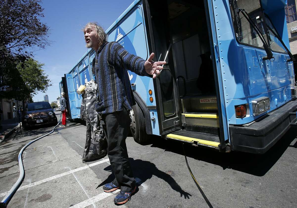 Silas Borden, a homeless man, emerged from the Lava Mae bus with a smile on his face thankful for a shower Tuesday June 24, 2014 in San Francisco, Calif. Lava Mae, the program that is turning old MUNI buses into showers for homeless people. began their test run in front of the Mission Neighborhood Resource Center.