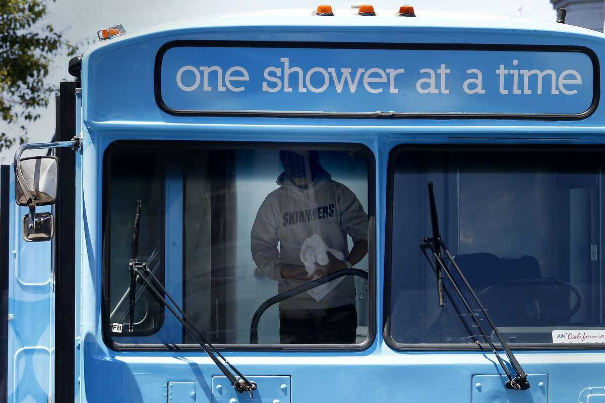 A homeless person emerged from his shower on the Lava Mae bus Tuesday June 24, 2014 in San Francisco, Calif. Lava Mae, the program that is turning old MUNI buses into showers for homeless people. began their test run in front of the Mission Neighborhood Resource Center.