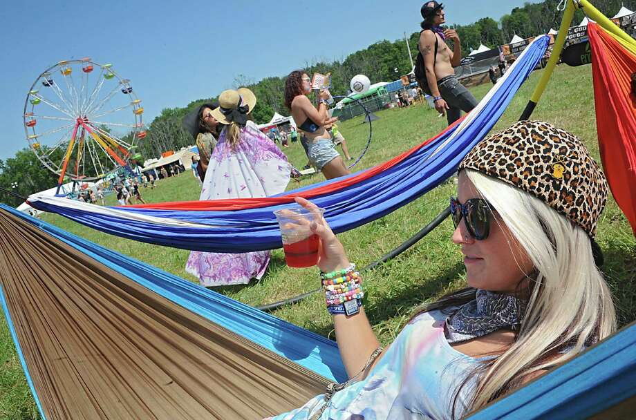 Jessi Cook, 26, of Mobile, Alabama relaxes in a hammock with a drink in hand at the Hudson Project music and arts festival on Winston Farm Friday, July 11, 2014 in Saugerties, N.Y.  (Lori Van Buren / Times Union) Photo: Lori Van Buren / 00027745A